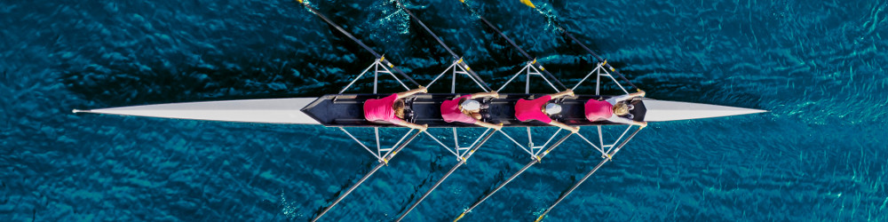 Rowing boat with 4 rowers pictured from above